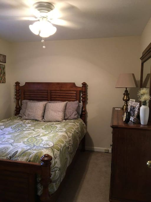 Master suite with a QUEEN bed and ceiling fan