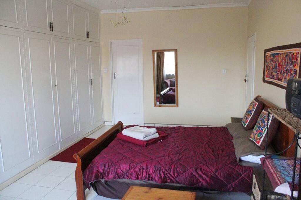 Bedroom - small door goes to private toilet/sink.