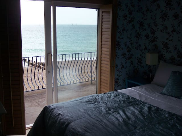 Small double room with balcony and beach view