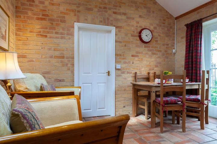 Spacious sitting and dining area,  tiled floor with underfloor heating