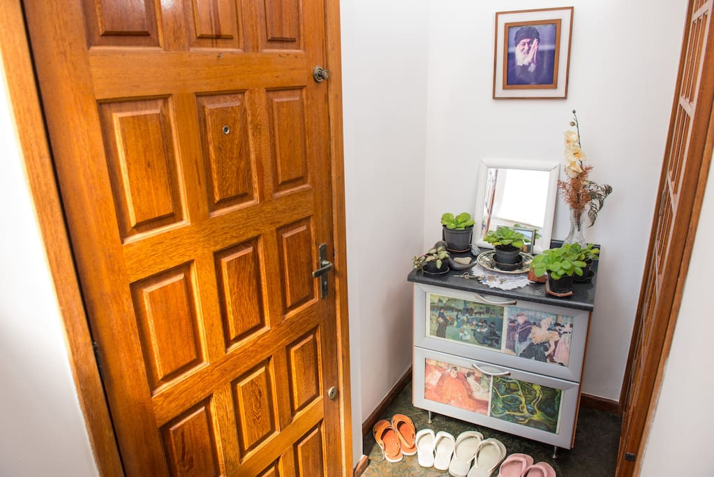 Entering the main door you will find the kitchen to your left and living room + rooms + bathrooms and terrace to your left.