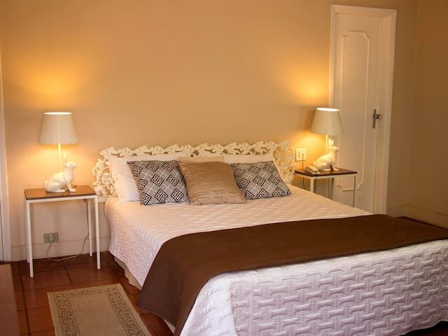 Queen size bed with cast iron headboard and furniture. Satellite TV channels, dresser, free Wi-Fi and air conditioning