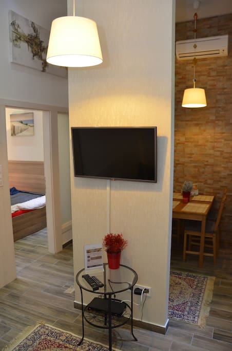 Living room with LCD TV and view to bedroom 2 and
