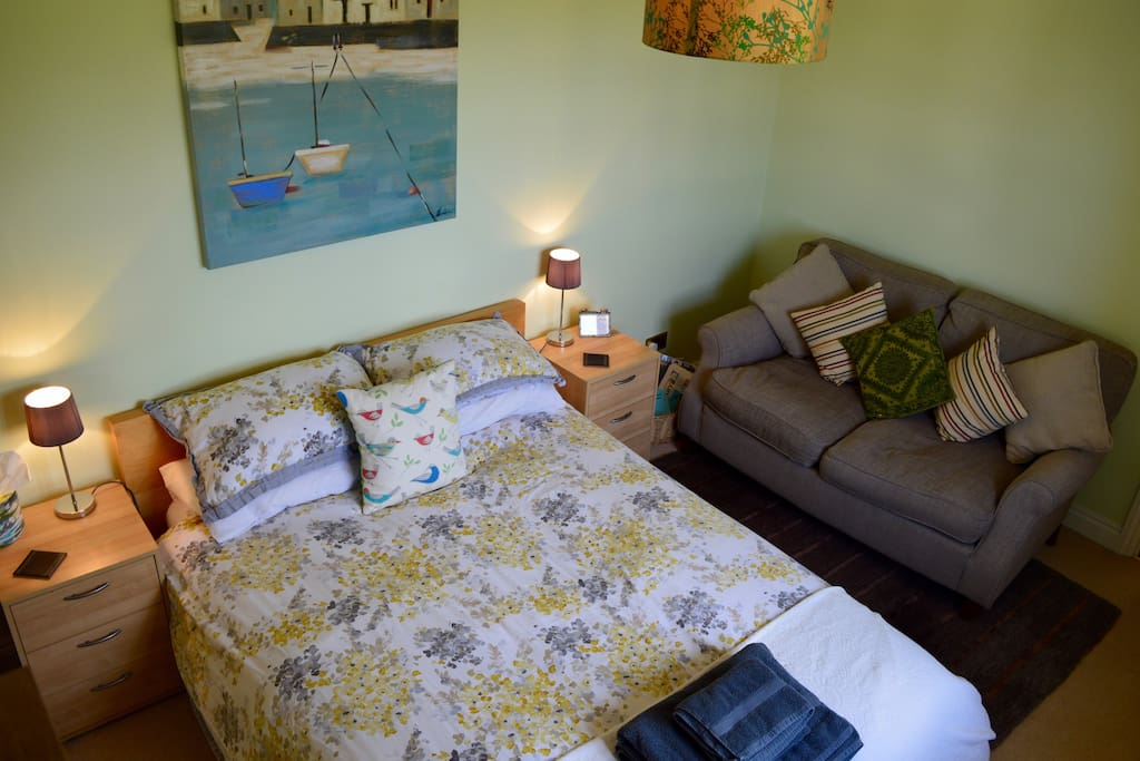 Comfy guest room with sofa for relaxing
