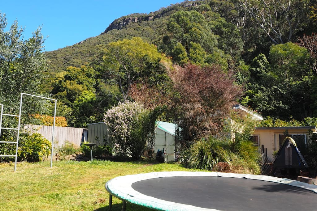 child-friendly backyard with trampoline and gymnastic bars and fabulous escarpment views