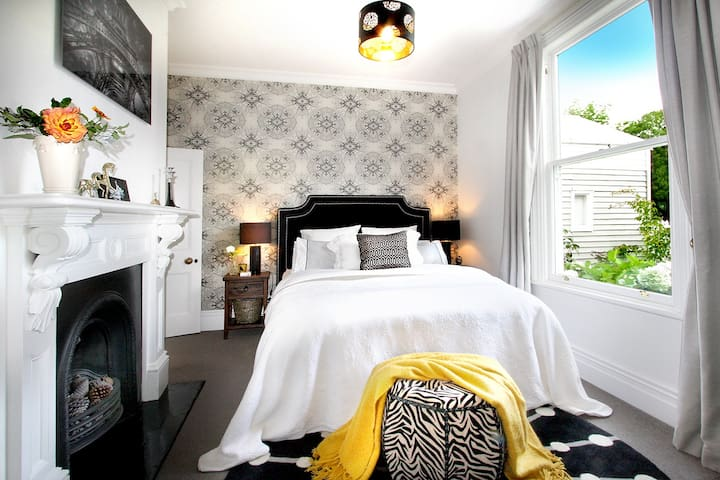 The luxurious master bedroom at Fox's Retreat with queen bed has a private ensuite.