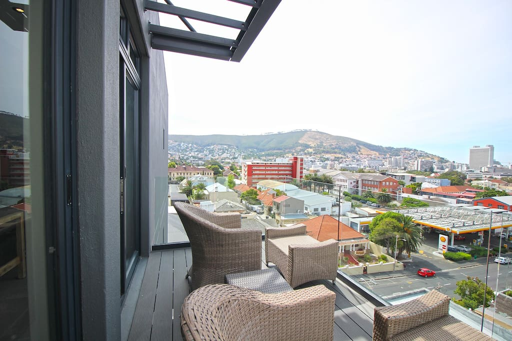 Balcony off the living area, outdoor seating and great views of Signal Hill and City