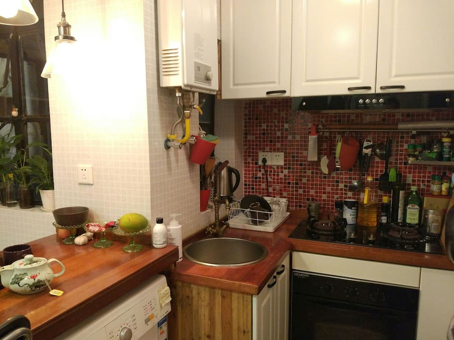 Kitchen with oven, 2 burners, hot water, and a washing machine