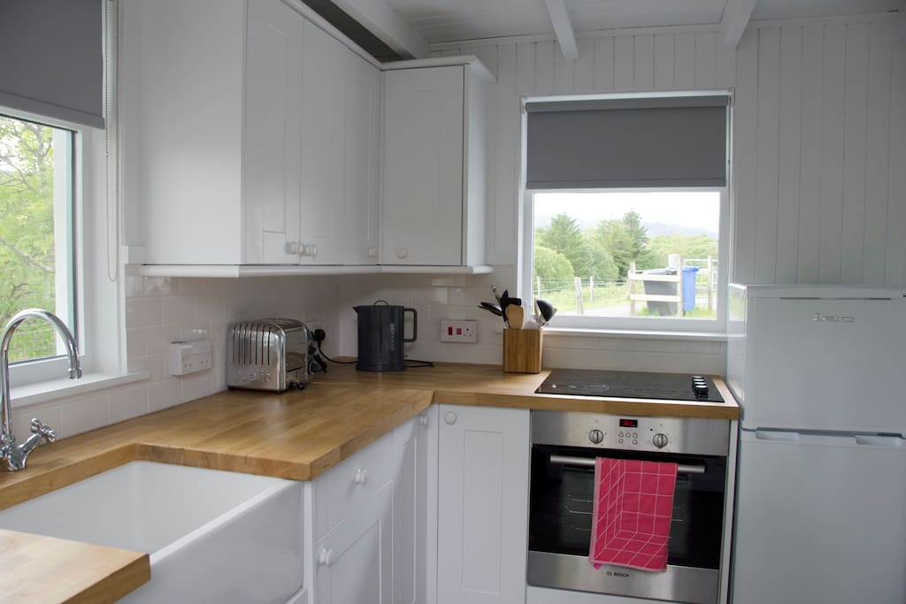 Well-equipped kitchen with a dishwasher, electric oven, hob, fridge freezer, kettle, toaster and food blender