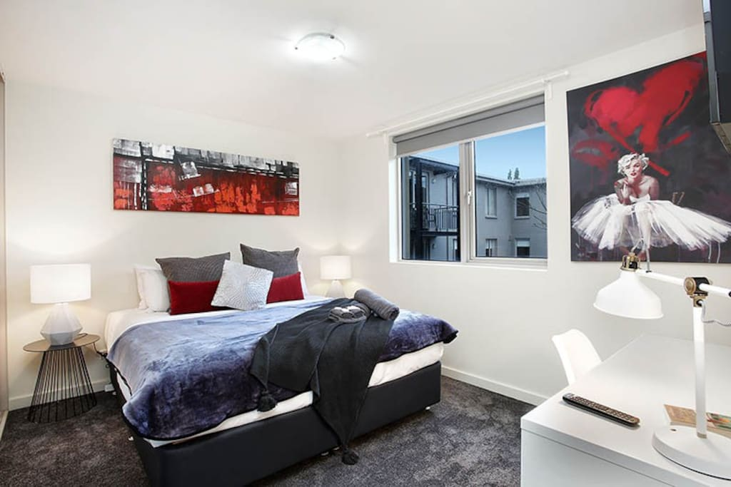 Spacious queen bedroom in in this 1-bedroom StayCentral St Kilda Serviced Apartment