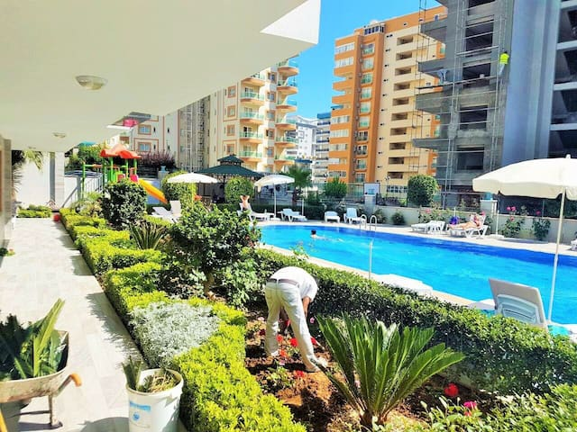 5mins walk from the beach. Swimming pool and gym.