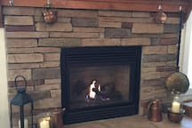 A cozy gas fireplace makes for a welcoming living room.