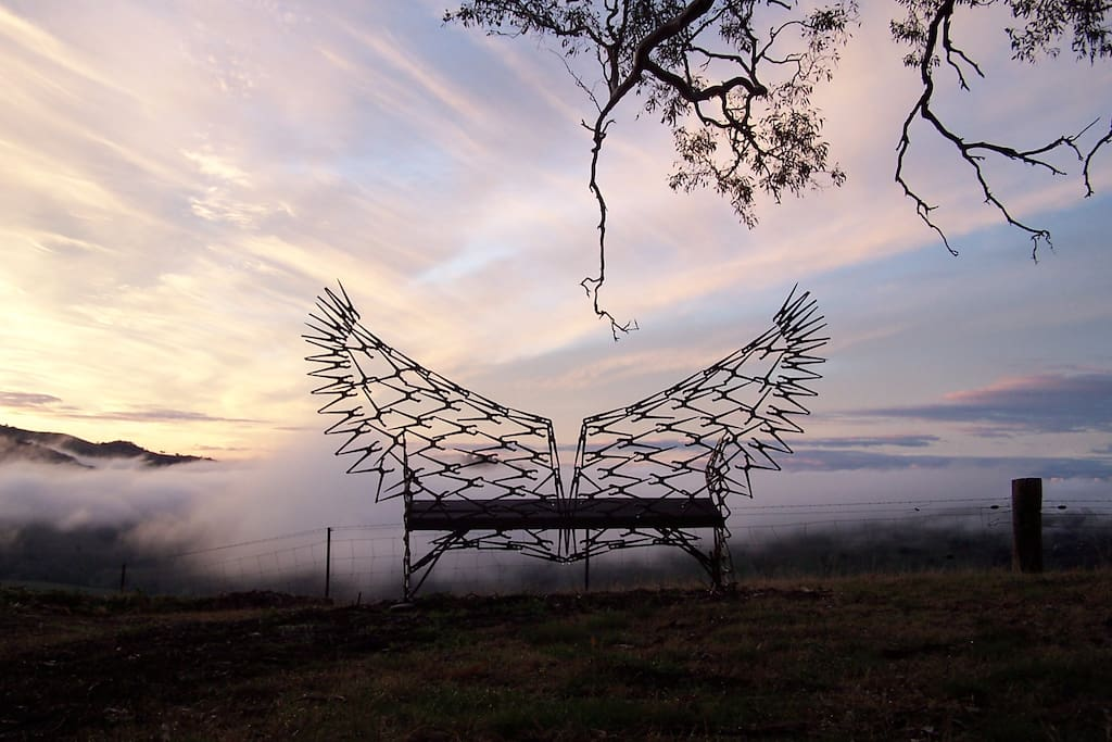 Wing Chair with fog over valley