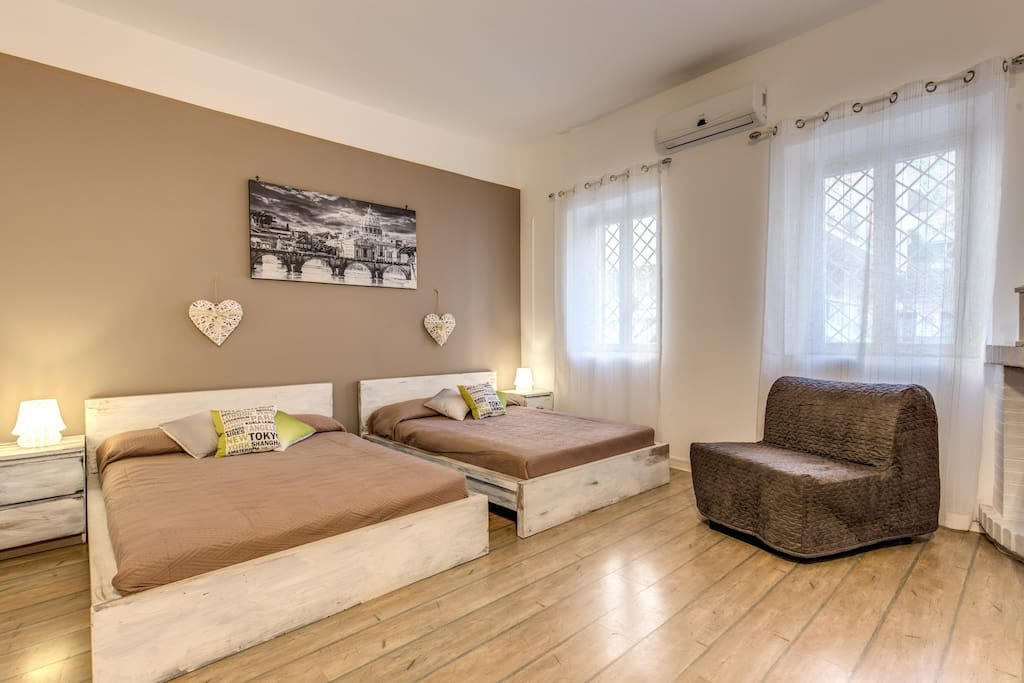 Open space with 2 double beds, 1 single sofa bed, TV, air conditioning/ heater