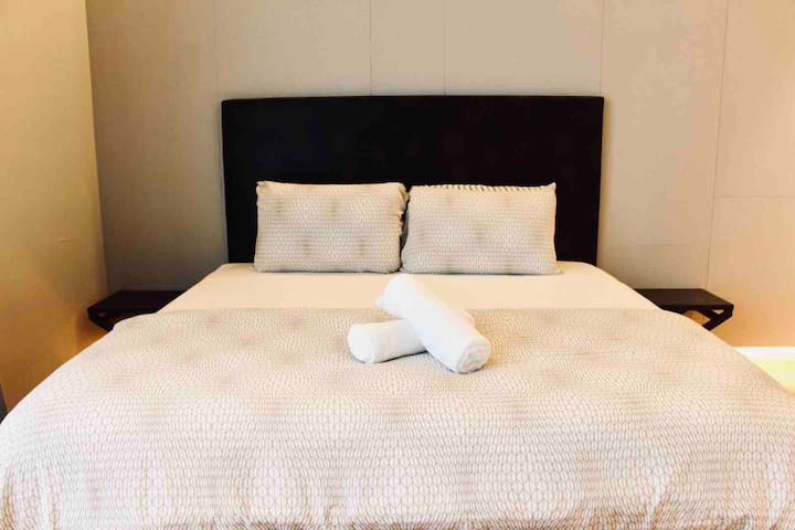 Comfy king sized bed in our master bedroom for your goodnight beauty sleep!