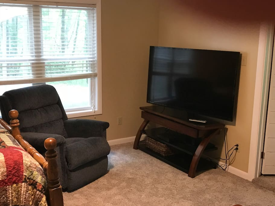 Master bedroom tv and comfy chair