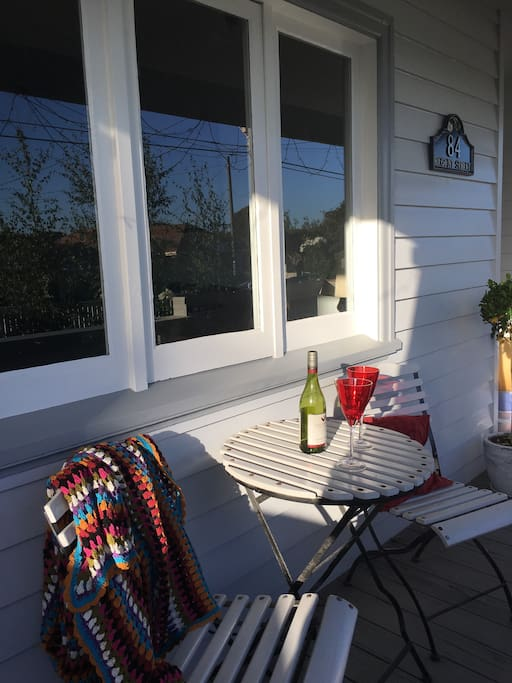 Enjoy a drink on the front porch.