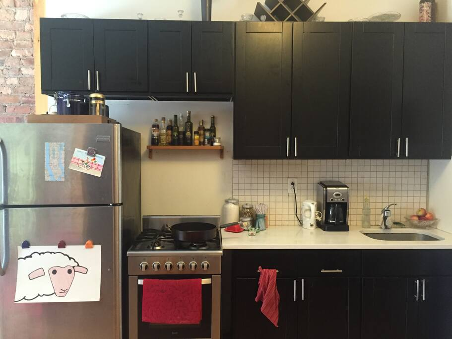 Gas oven & stove, electric kettle and coffee maker.