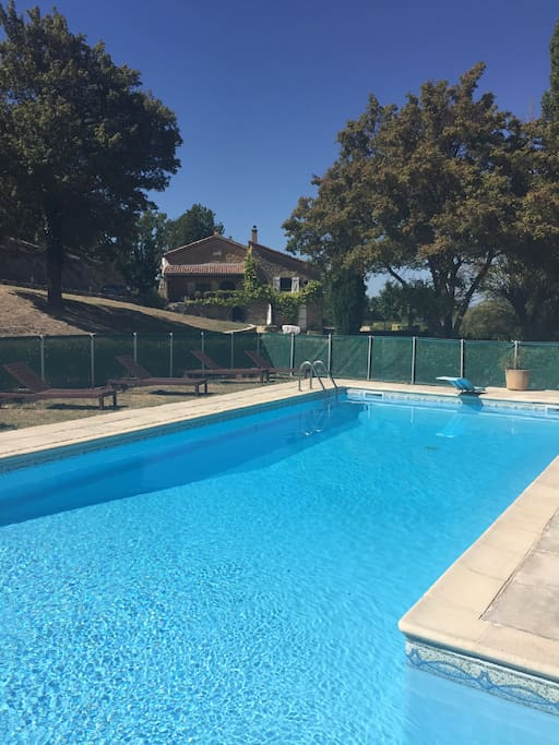 Swimming pool with approved safety fence