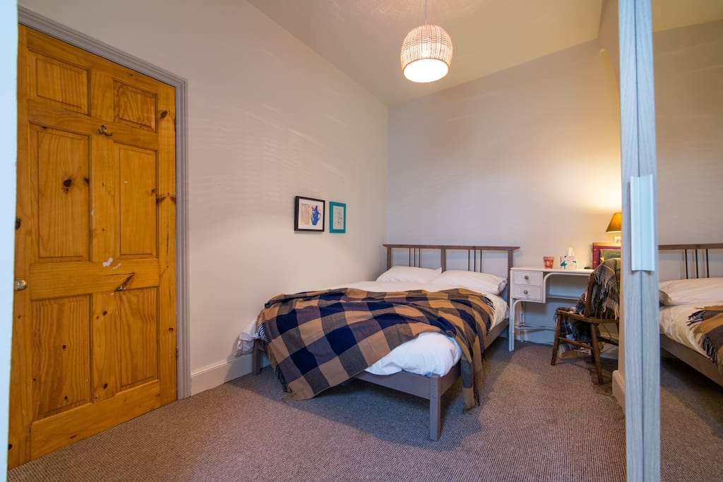 Private double room with standard double bed and vintage dresser