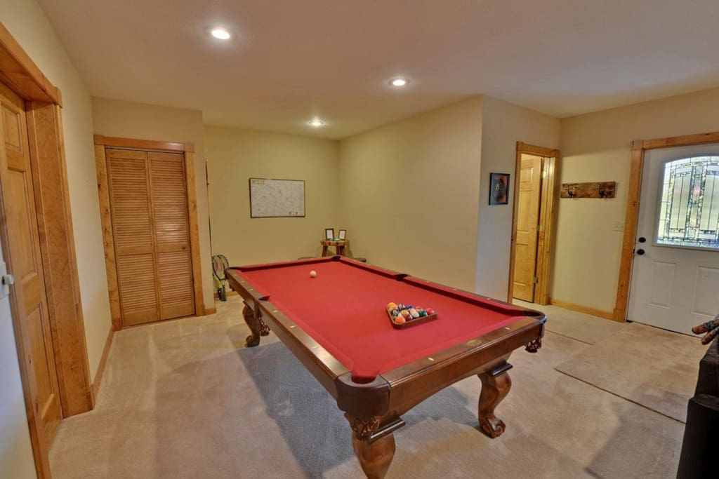 Full size pool table in the terrace level game room
