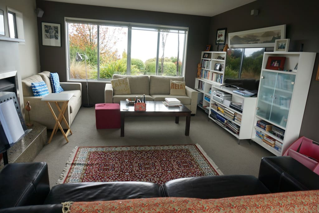 Separate lounge with gas fire and flat screen TV.
