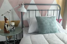 guest room with a single bed & table lamp