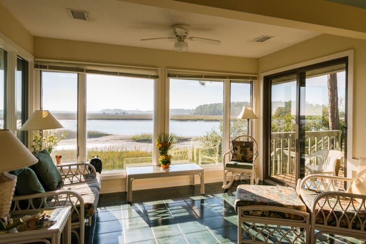 Waterfront cottage w/ deck, river views, & shared pool & hot tub