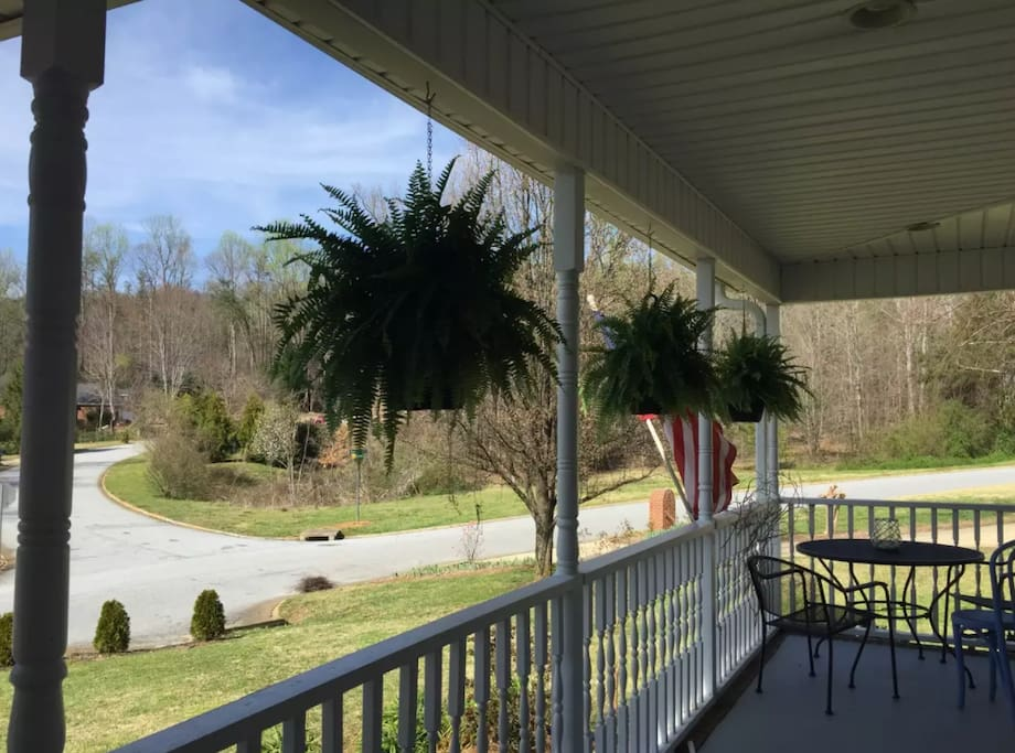 Wrap-around front porch with view of Paris Mountain