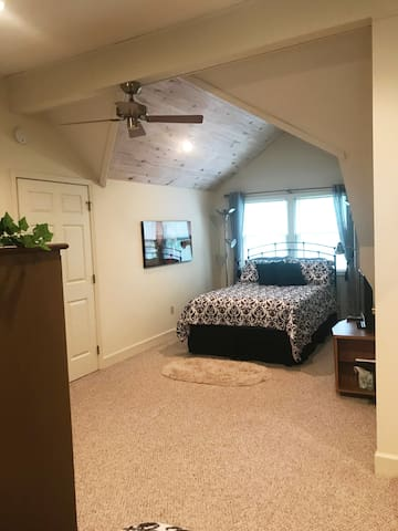 Bedroom 4 is located on the second floor and has lots of character!