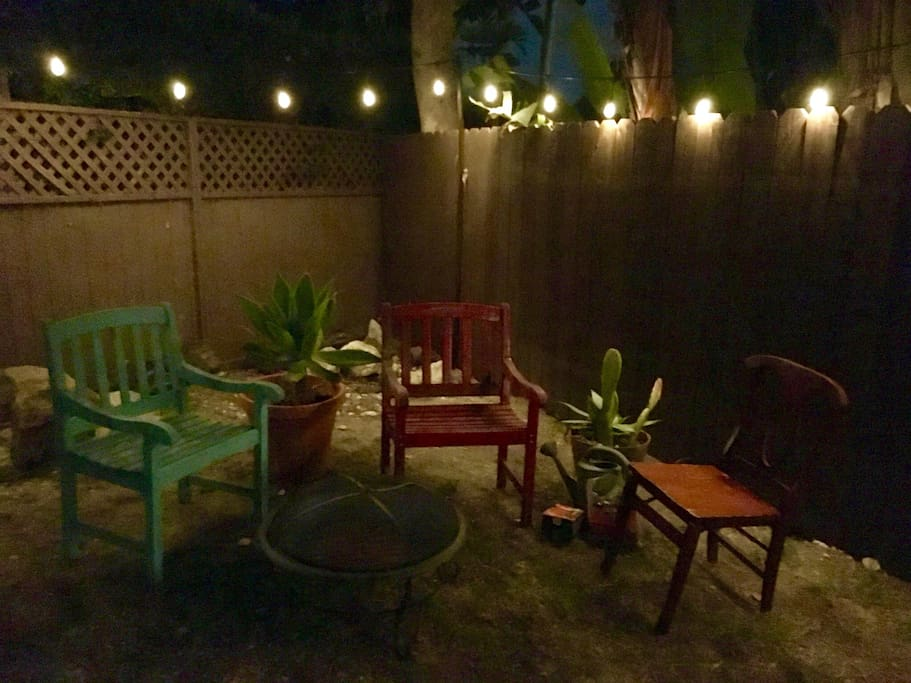 Our backyard is lit up at night and has a hammock for you to use!