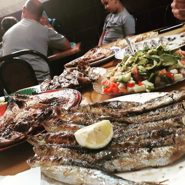 Grilled fish meal with  salad