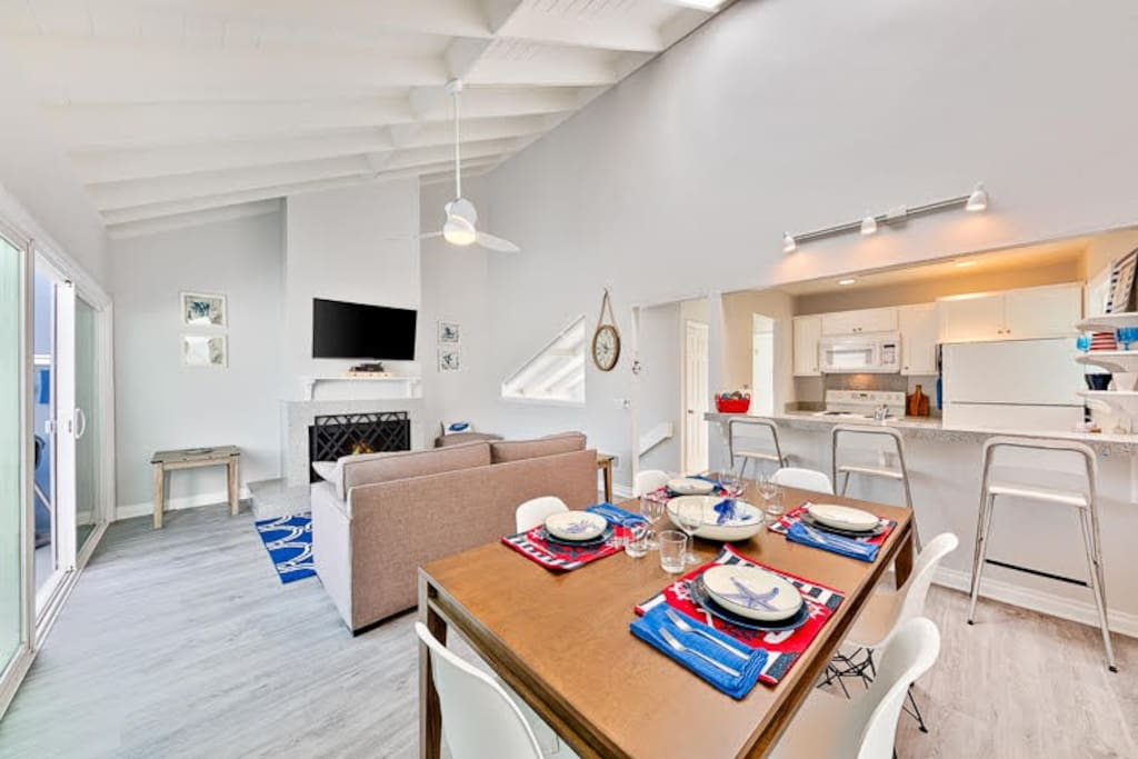 The Grand Room of this unit come with a Queen sleeper sofa, a 50 Inch Smart TV and a dining table that seats 6. There is also a second patio off the Grand Room with an Al Fresco dining table and a BBQ.