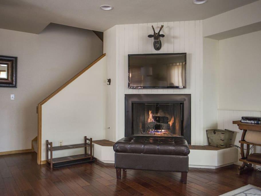 Wood burning fireplace and large HDTV