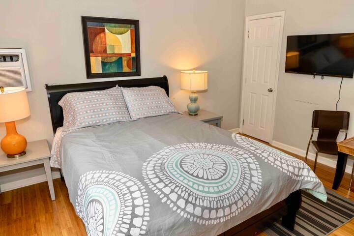 Comfy queen bed with TV.