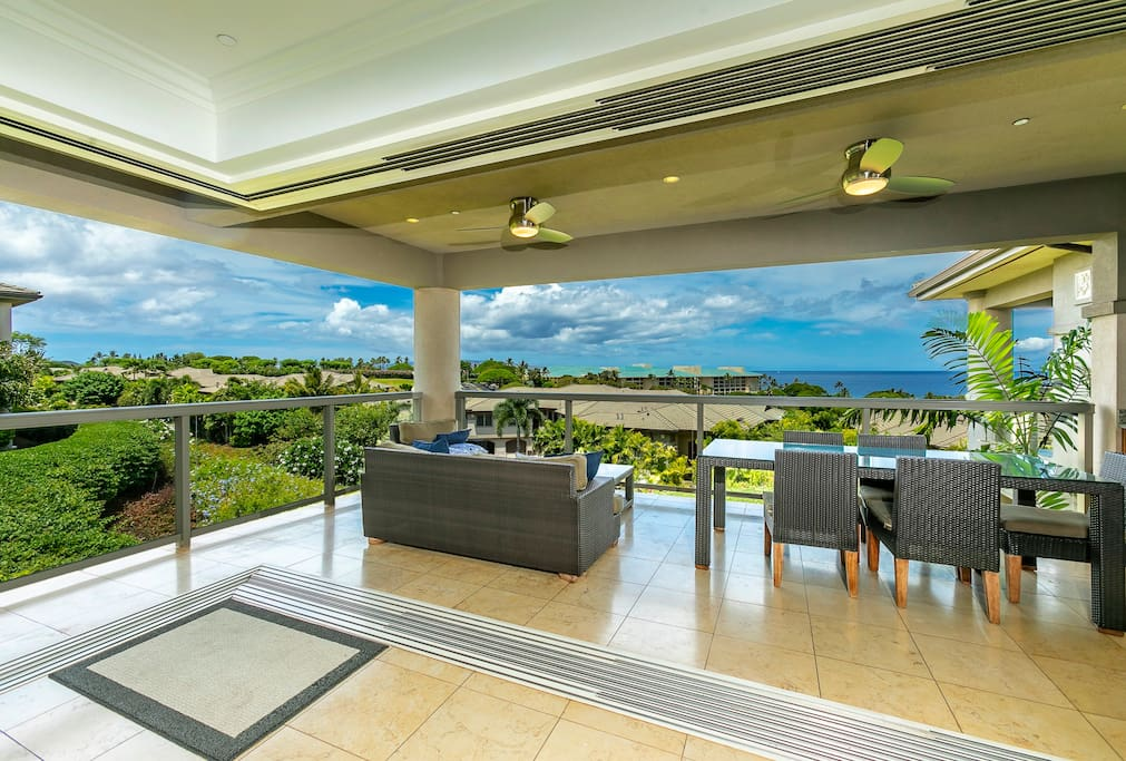 Living room extends out to upper lanai with ocean views