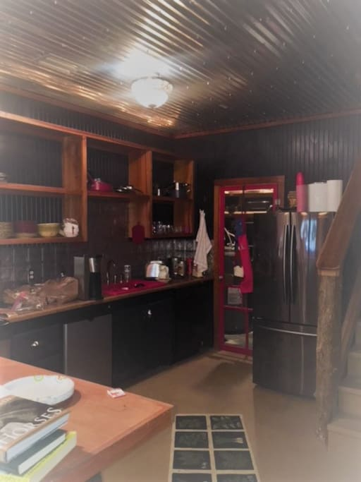 Kitchen with new refrigerator, dishwasher, stove, microwave