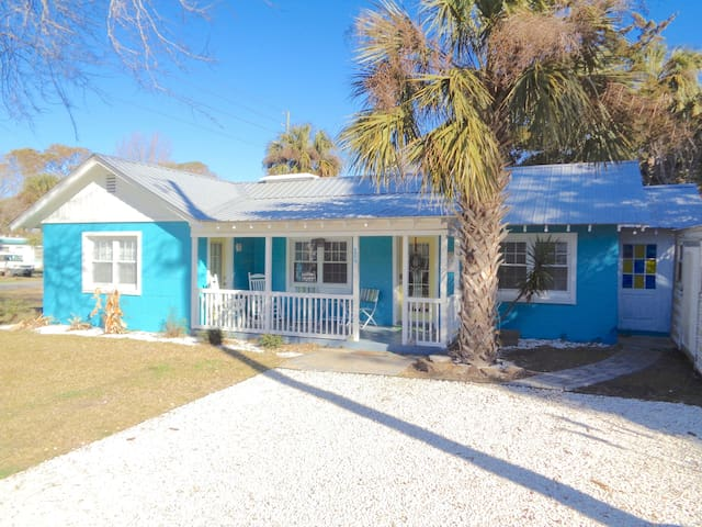 Cute and bright 1 story bungalow with inviting front porch and plenty of parking!