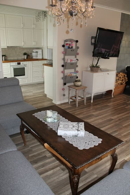 View from sofa in living room / dining room into the kitchen.