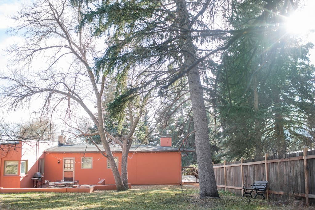 Enjoy the peaceful back patio space and seating area in the expansive open yard!