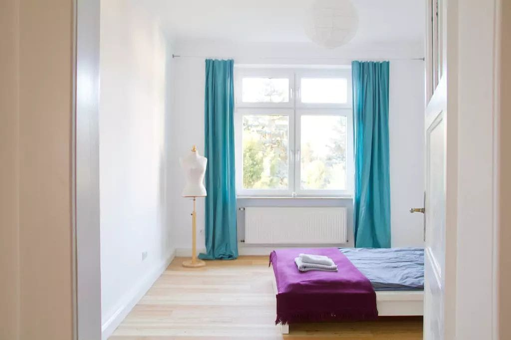 Comfortable and quiet sleeping room with queen size bed and garden view