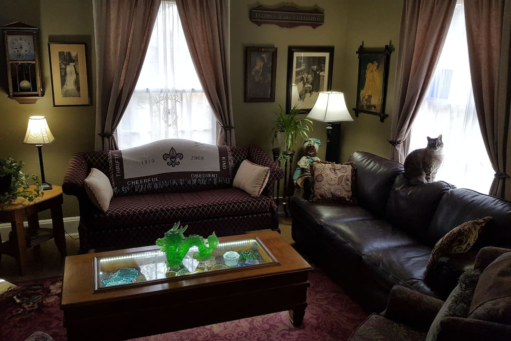 "The parlor, plenty of sitting room, features a 60"" HDTV with Surround Sound, great for a movie night!"