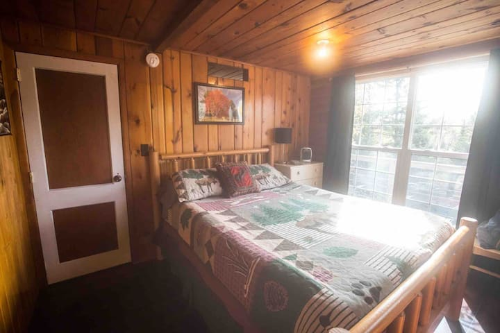 New Queen bed inside of bedroom of Cabin Brooke