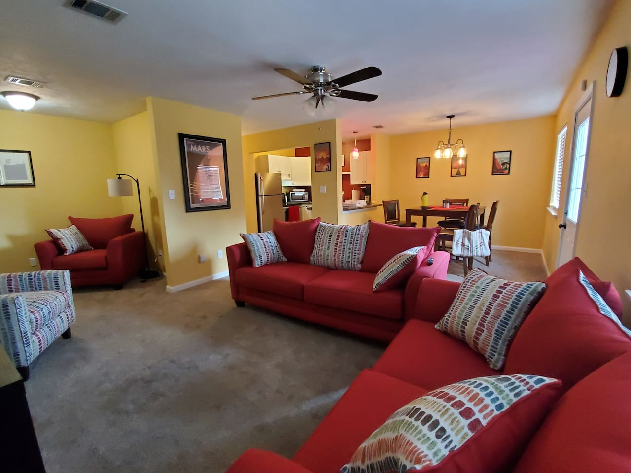 Plenty of seating in an open plan living room.