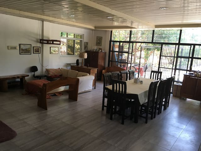 The main room in the poolhouse can accommodate more guests.