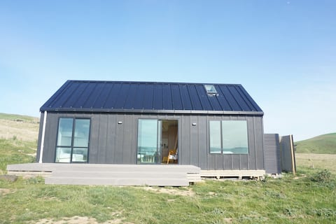 The Little Black Barn overlooking Curio Bay