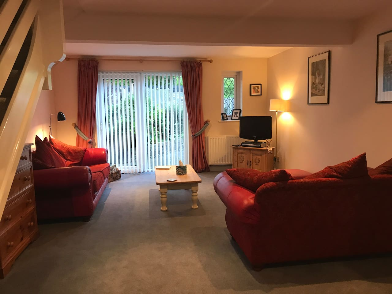 Spacious lounge, light and airy. Views of the garden and pond.