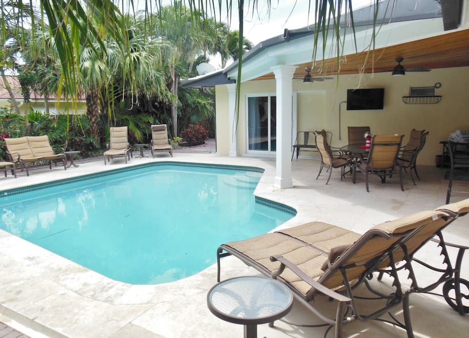 Enjoy the large, heated pool while watching TV poolside.
