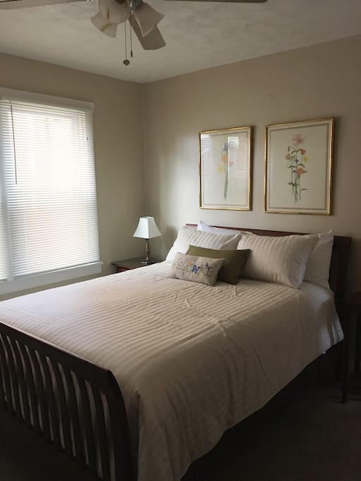 The largest of the two bedrooms has a queen size, Stearns & Foster pillow-top mattress, with Hemstitch 400-Thread-Count Egyptian Cotton Sateen White Sheets.