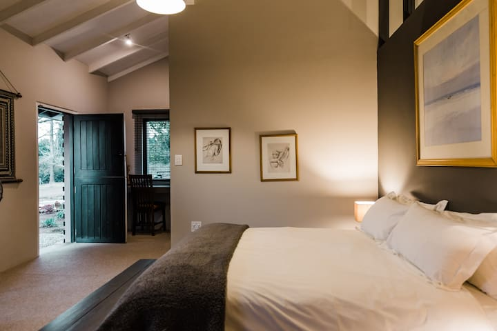 Bedroom with stable door leading to private garden.